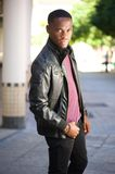 Black male fashion model posing in leather jacket Royalty Free Stock Images