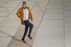 Black male fashion model posing outdoors in casual clothes. Portrait of a black male fashion model posing outdoors in casual clothes Royalty Free Stock Photo