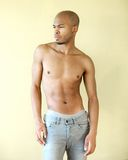Black male fashion model posing shirtless. Portrait of a black male fashion model posing shirtless Royalty Free Stock Photography