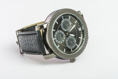 Black male hand quartz Watch. Black men`s quartz watch on a leather strap on a table on a white background Stock Photo