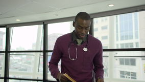 A Black Male Medical Professional Walks Up to the Camera (3 of 5)