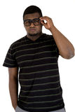 Black male model with a casual look wearing black glasses Royalty Free Stock Photography