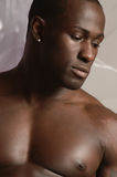 Black male portrait. Dark african american male in deep thought Stock Image