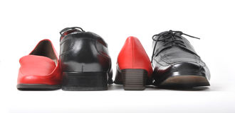 Black male shoe and red female Royalty Free Stock Photography