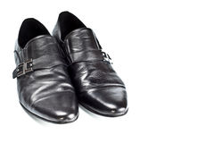 Black male shoes with buckles. Isolated on white Royalty Free Stock Photos
