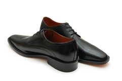 Black male shoes isolated on t. He white - more footware in my portfolio Royalty Free Stock Images