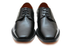 Black male shoes isolated on the white. Black  male shoes isolated on the white Royalty Free Stock Photo