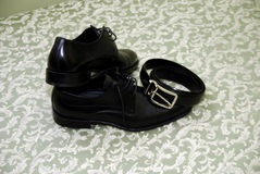 Black male shoes and weist band Royalty Free Stock Image