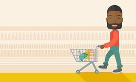 Black Male Shopper Pushing a Shopping Cart Stock Photo