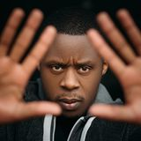 Black male with stop gesture in selective focus royalty free stock photography