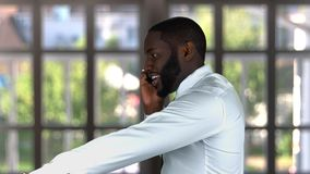 Black male talking on phone. stock footage