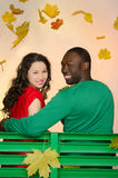 Black man and asian woman under the leaves Royalty Free Stock Photos
