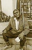 Black man begging Stock Photo
