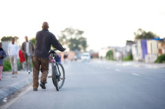 Black man with a bicycle. Stock Image