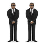 Black man bodyguard stands in closed pose Royalty Free Stock Image