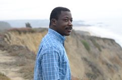 Black Man at the California Coast. Black man gazing at the coast Stock Image