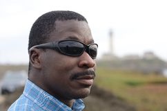 Black Man at the California Coast. Black man gazing at the coast Royalty Free Stock Photography