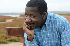 Black Man at the California Coast. Black man gazing at the coast Royalty Free Stock Photo