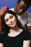 Black man caress white woman hair, couple in love. Black men caress white women hair, closeup. Interracial relationship, international couple in love, tenderness Royalty Free Stock Photos