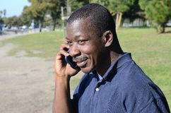 Black Man on the Cell Phone. In the park Stock Image