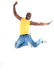 Black man cheerful. Black strong man jumping on white background Stock Photo