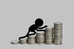 Black man climbing to the top of money for success concept Royalty Free Stock Photos