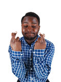 Black man crossing finger. Stock Photography