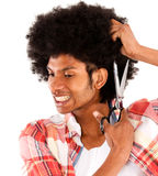 Black man cutting his afro Stock Images