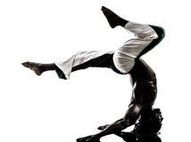 Black man dancer dancing capoeira  silhouette Royalty Free Stock Photography