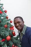 Black man decorating the Christmas tree Stock Image