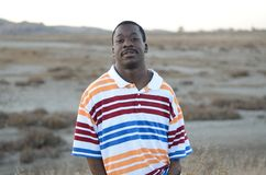 Black Man In The Desert. On a cold day Stock Photo