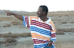 Black Man In The Desert. On a cold day Stock Photos