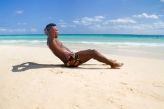 Black man does ABS Exercises royalty free stock photo