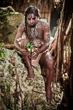 Black man with dreadlocks in the image of the Taino Indian in his habitat. Black man with dreadlocks in the image of the Taino Indian in habitat, body painting Royalty Free Stock Photo