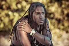 Black man with dreadlocks swears Royalty Free Stock Photo