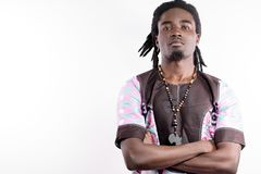 Black man with dreadlocks in traditional colorful cloth. African man with dreadlocks in traditional colorful cloth royalty free stock photos