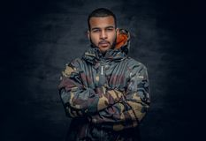 Black man dressed in military jacket. Studio portrait of Black man dressed in military jacket Royalty Free Stock Photography