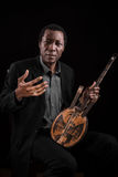 Black man with ethnic musical instrument Royalty Free Stock Image