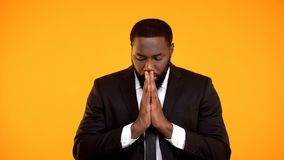 Black man in formal suit praying for successful negotiations important interview. Stock photo stock photography