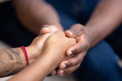 Black man friend holding hands of african woman, closeup view royalty free stock image
