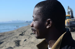 Black Man Gazing Into The Sea Stock Photos