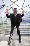 Black man getting crazy about business network Stock Photos