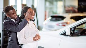 Black Man Giving Surprise To Wife By Purchasing New Car. Black Man Giving Surprise To Her Wife By Purchasing A New Car Stock Photo