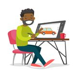 A black man graphic designer works at the office desk. A black man graphic designer or freelance artist works using a pen and touch screen at the office desk Royalty Free Stock Photo
