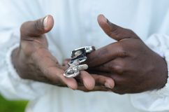 Black Man Hands. Holding watch Stock Images