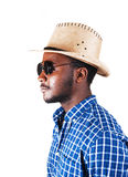 Black man with hat and glasses. A serious looking black man in a profile picture with a cowboy hat, and sunglasses, isolated for white background royalty free stock photos