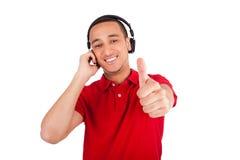 Black man having fun listening to music Stock Image