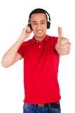 Black man having fun listening to music Royalty Free Stock Images
