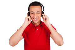 Black man having fun listening to music Stock Images