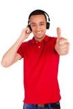 Black man having fun listening to music Stock Images